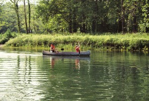 having fun exploring in a canoe while camping